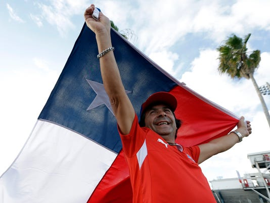 Eduardo Gonzalez of Fort Lauderdale, Fla. waves a Chilean flag before an international friendly soccer match between Chile and Haiti, Tuesday, Sept. 9, 2014, in Fort Lauderdale, Fla. (AP Photo/Lynne Sladky)