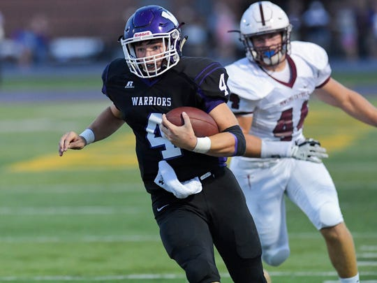 Waukee Quarterback Mitch Randall (4) runs the ball on Friday, Sept. 15, 2017, during a football game between the Waukee Warriors and the Dowling Maroons at Waukee stadium.