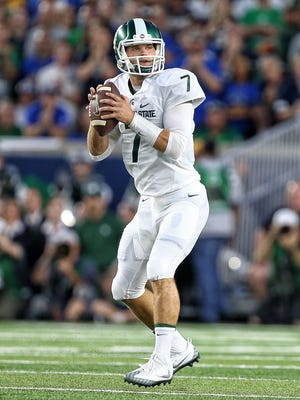 Sep 17, 2016; South Bend, IN, USA; Michigan State Spartans quarterback Tyler O'Connor attempts to throw against Notre Dame.