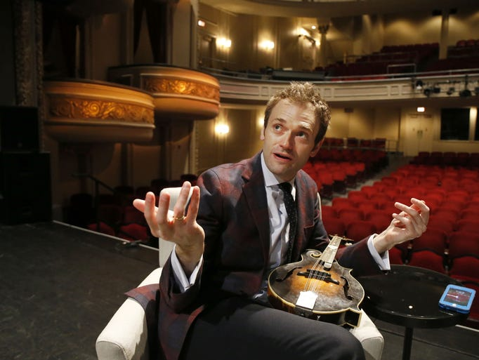 In this April 5, 2016 photo, Chris Thile gestures during