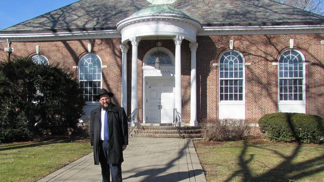 Rabbi Meir Borenstein, of Chabad of Orange County, stands in front of the former Goshen library building on Main Street on Thursday.