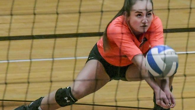 Garden City High School's McKenna Jagels digs a shot against Dodge City Thursday at GCHS.
