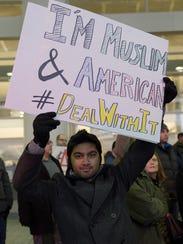 Taosif Alam of Farmington Hills protests at Detroit