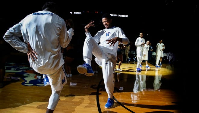 University of Memphis guard Markel Crawford (right) dances with teammate Keon Clergeot (left) during player introductions before taking on University of Texas Rio Grande Valley during their season opener at FedExForum.