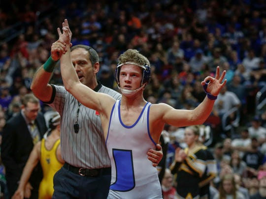 Underwood junior Alex Thomsen celebrates after winning the Class 1A state title at 126 pounds over Wapsi Valley junior Donny Schmit during the Iowa Class 1A wrestling finals on Saturday, Feb. 18, 2017, at Wells Fargo Arena in Des Moines.