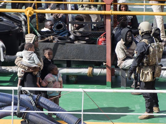 Armed forces stand onboard the Turkish oil tanker El Hiblu 1, which was hijacked by migrants, in Valletta, Malta.
