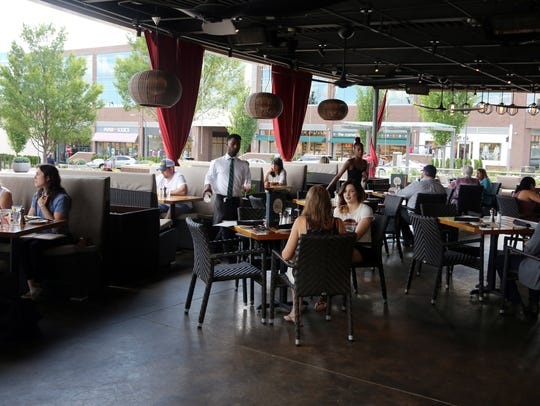 Diners enjoy the outdoor seating at Del Frisco's Grille