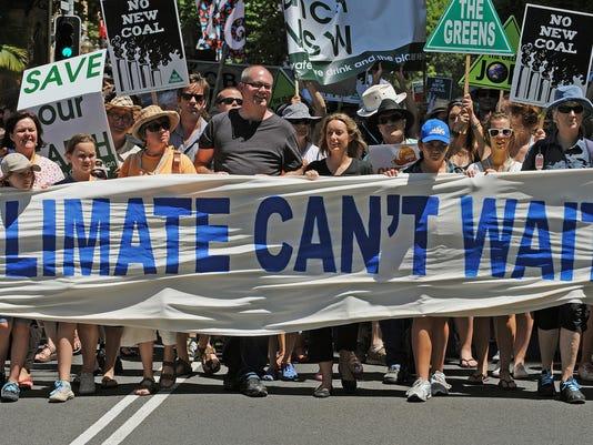 Climate change activists march through S