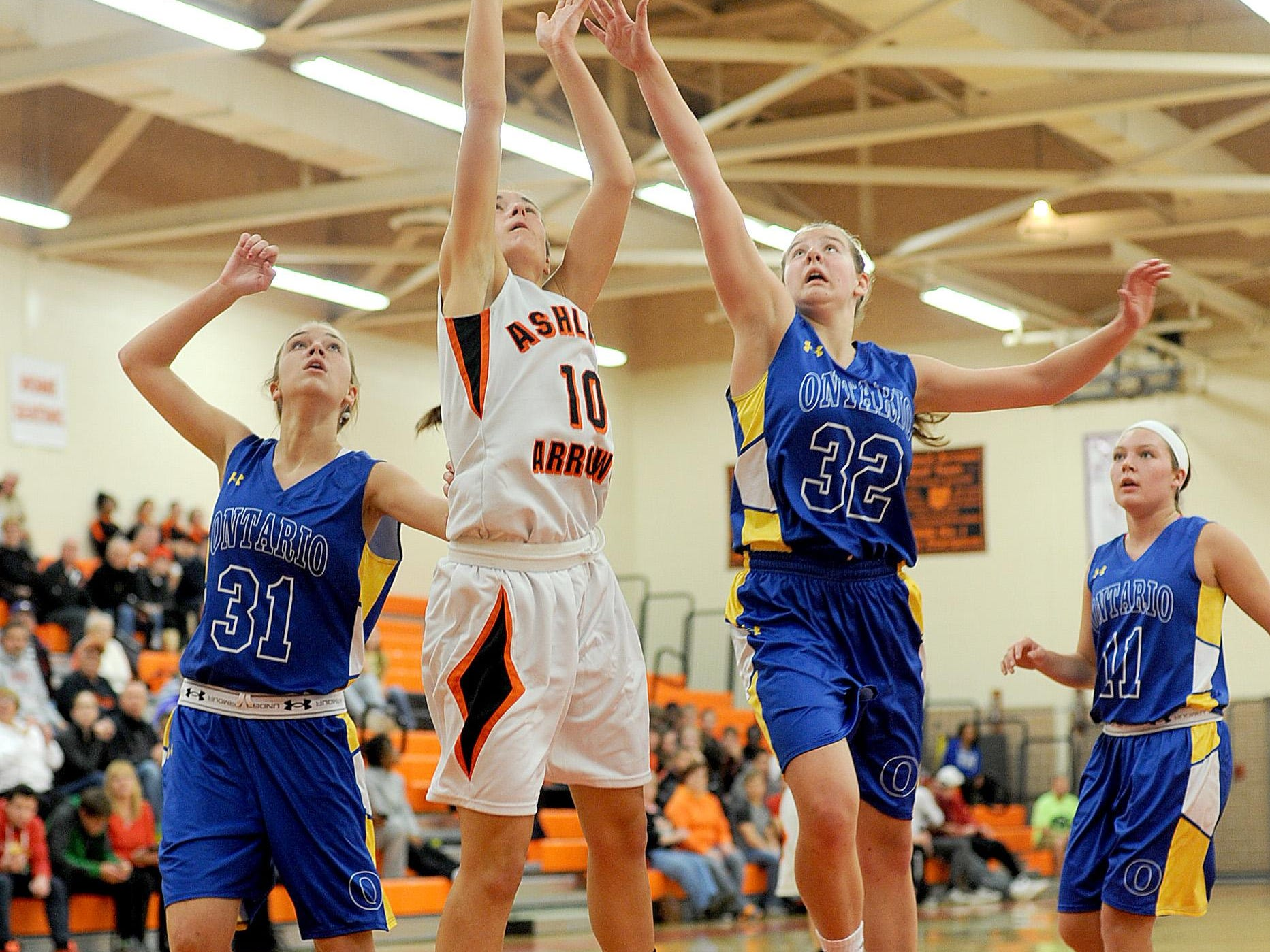 Ashland's Mady McQuate gets by Maddie Payne, Madeline Collins and Faith Nigh of Ontario on Tuesday at Ashland High School.