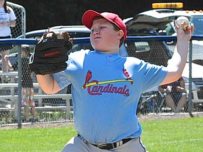 Winning pitcher Adam Bloch prepares to deliver a pitch. The Ramapo Cardinals edged the West Nyack Athletics 3-2 in the title game of the Tournament of Champions, June 21, 2014.