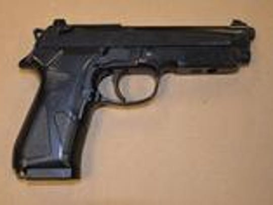 Police say this gun was recovered after repeat armed robbery suspect Clayton Bush of Wilmington tossed it Wednesday as officers chased him following his armed robbery of a city pizza shop.