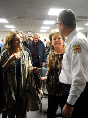 Donna Littlefield, records program manager for the Abilene Police Department, gets a hug from Abilene Fire Chief Larry Bell after her retirement ceremony Wednesday, Jan. 4, 2017, at the Abilene/Taylor County Law Enforcement Center.