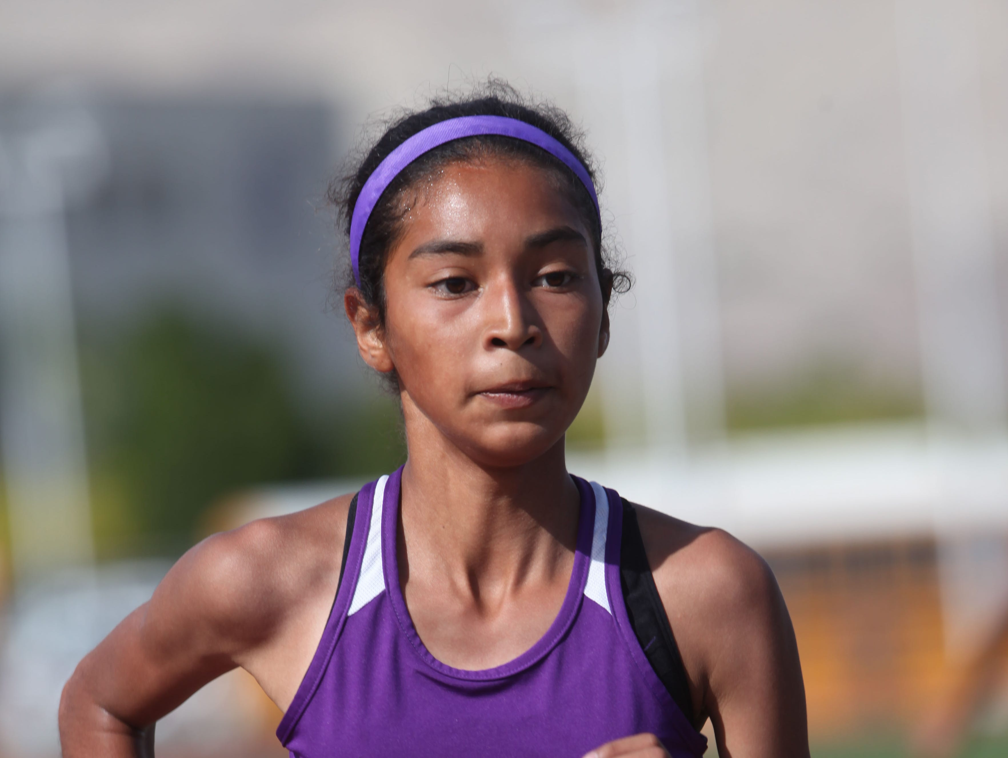 Shadow Hills High School's Nyah Chavez runs the 1600 meters in 5:20 as a freshman and finished first against Rancho Mirage High School runners in Indio.