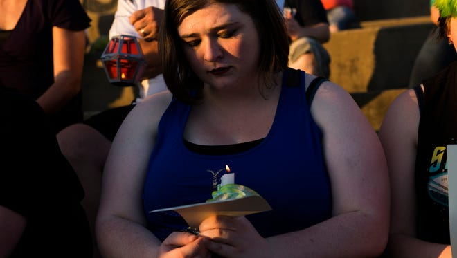 Emily Reeve listens to names read at Pulse shooting vigil in Clarksville on June 12, 2017.