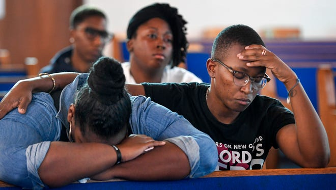 Gicola Lane and D.J. Hudson react to Mayor David Briley's announcement about the police shooting of Daniel Hambrick, as they listen to a press conference at Jefferson Missionary Baptist Church, Wednesday, Aug. 8, 2018, in Nashville,Tenn.