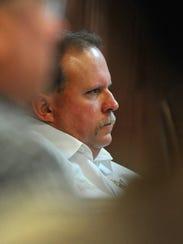 Wichita County Sheriff David Duke listens as representatives