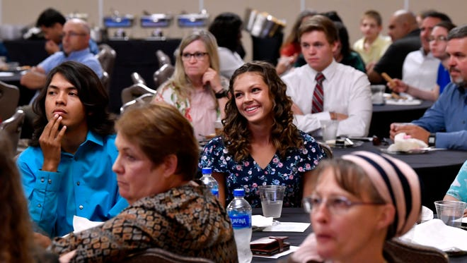 Students and their guests listen to Katie Alford, president and CEO of Community Foundation of Abilene, speak during the Star Student Awards banquet at Abilene Christian University on Tuesday.