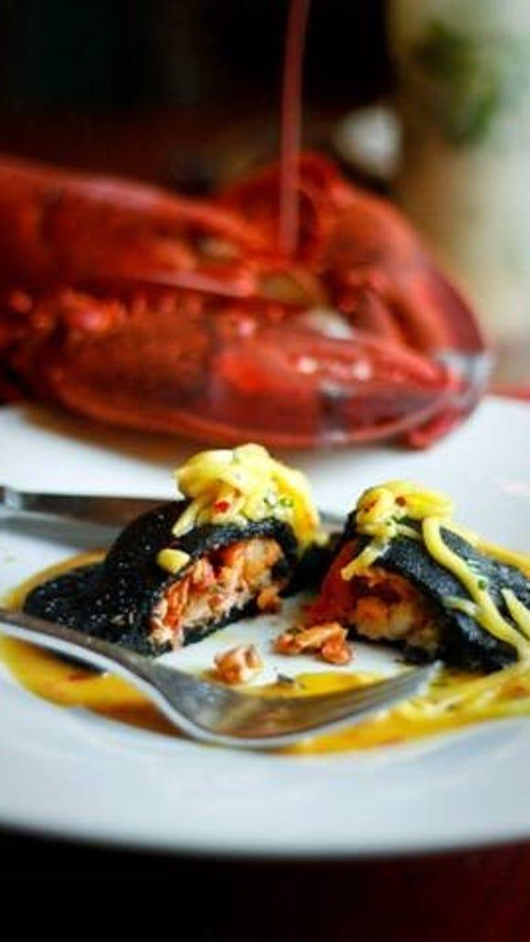 A jet-black lobster empanada is a special for National Empanada Day at Cuba Libre.