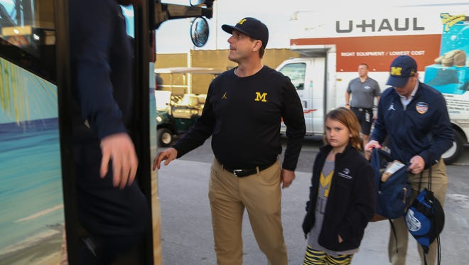 Michigan football coach Jim Harbaugh arrives  before the Orange Bowl against Florida State on Dec. 30, 2016, in Miami Gardens, Fla.