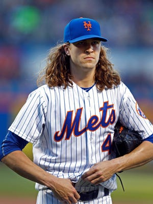 May 31, 2017; New York City, NY, USA;  New York Mets starting pitcher Jacob deGrom (48) walks to the dugout after pitching in the first inning against the Milwaukee Brewers at Citi Field. Mandatory Credit: Noah K. Murray-USA TODAY Sports