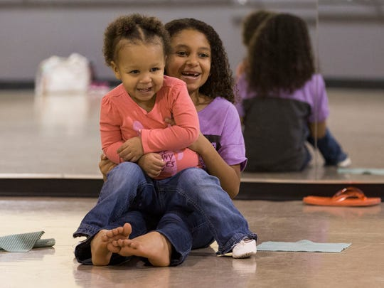 Lillinae Humbane, 8, plays with her little sister, Laurilyn, 2, while they are at the Mommy and Me class at D'Alto Studio Tuesday night.