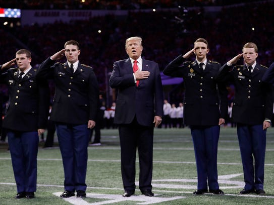 President Donald Trump sings the national anthem before