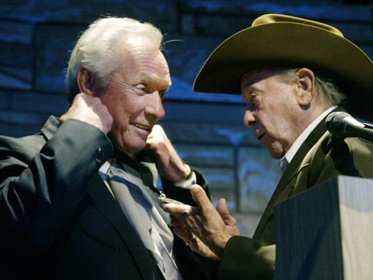 """Mel Tillis, left, receives his Country Music Hall of Fame medallion from """"Little"""" Jimmy Dickens during the Medallion Ceremony Oct. 28, 2007."""