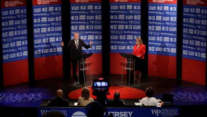 Democratic nominee Phil Murphy, left, answers a question as he participates in a gubernatorial debate against Republican nominee Lt. Gov. Kim Guadagno at William Paterson University.