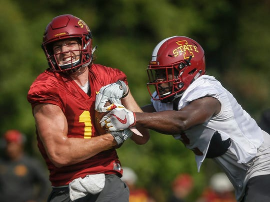 Iowa State senior linebacker Willie Harvey, right, grabs the ball after tight end Chase Allen pulled in a pass during open practice on Aug. 3, 2018, at Iowa State in Ames.