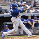 Kansas City Royals shortstop Alcides Escobar hits a double to left during the fifth inning against the New York Yankees Saturday at Yankee Stadium in New York.