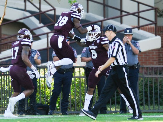 Mississippi State players celebrate after recovering a blocked punt against Louisiana Tech.
