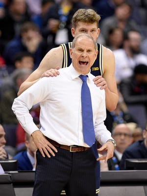 Michigan head coach John Beilein, front, reacts in front of Michigan forward Moritz Wagner during the second half of an NCAA college basketball game against Purdue in the Big Ten tournament, Friday, March 10, 2017, in Washington. Michigan won 74-70 in overtime.
