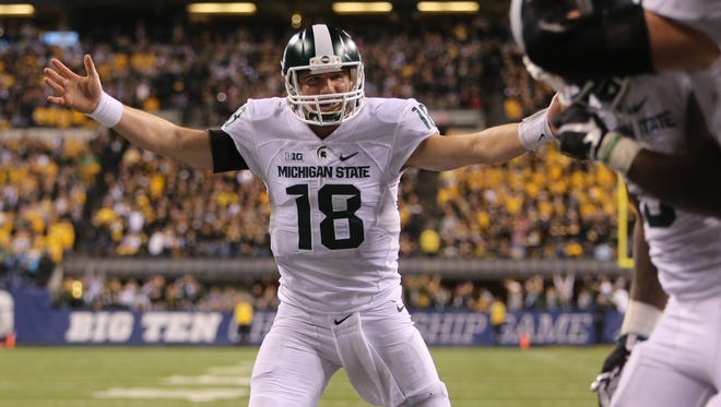 Connor Cook celebrates MSU's last minute touchdown in the fourth quarter to defeat  Iowa 16-13 in the 2015 Big Ten conference championship at Lucas Oil Stadium in Indianapolis.