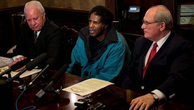 Lawrence McKinney speaks at a press conference held at the law office of Jack Lowery in Lebanon, Tenn., as attorneys Jack Lowery, Sr., left, and David Raybin, right, look on Wednesday, Dec. 20, 2017. Earlier that day Gov. Bill Haslam on exonerated McKinney, was released from prison in 2009 after a court overturned his 1978 conviction for rape and burglary because of DNA evidence.