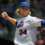 New York Mets starting pitcher Noah Syndergaard throws during the first inning Sunday against the Milwaukee Brewers in New York.