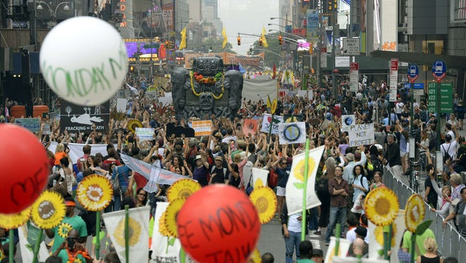 Marchers fill 6th Ave during the People's Climate March in New York.