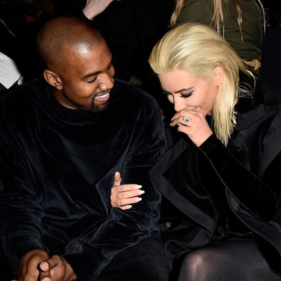 Kanye West and Kim Kardashian West at a fashion show