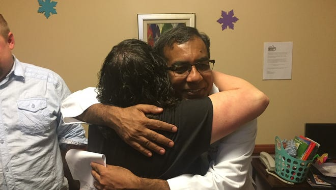 Jackie Chapman of Elmer hugs Dr. Muhammad Anwar, the chief of neonatology, at Inspira Medical Center Vineland during a April 12, 2018 reunion in the Ronald McDonald Family Room, where she stayed while her daughter, Grace Victoria, was treated in the neonatal intensive care unit.