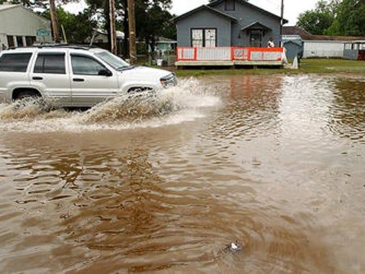 635998747221721821-Carencro-flooding-file.jpg