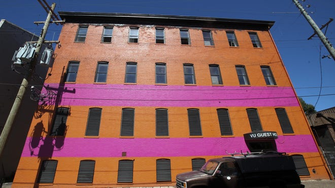 Businessman George Stinson's banquet hall would complement Vu Guest House, which is nearing completion on the west side of Floyd, just north of Breckinridge. This hotel, which is currently painted orange and pink, is a renovated, four-story converted warehouse and will have about 50 rooms.