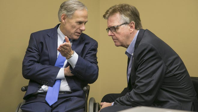 Gov. Greg Abbott, left, is shown with Lt. Gov. Dan Patrick at a 2017 briefing about Hurricane Harvey recovery efforts.