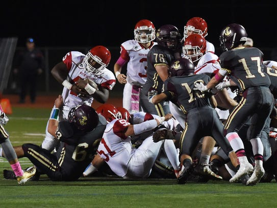 North Rockland's Andre Francois, left, struggles to