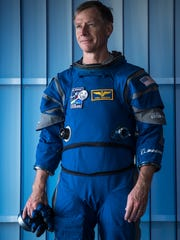 Boeing's Chris Ferguson, a former NASA astronaut, shows off the pressure suit crew members will wear in Boeing's CST-100 Starliner capsule.
