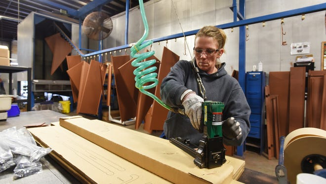 Jodi Davis packages parts at Bilco in the EastPointe Business Park in Zanesville. Bilco came to the park in 2007.