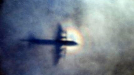 In this March 31, 2014, photo, the shadow of a Royal New Zealand Air Force P3 Orion is seen on low level cloud while the aircraft searches for missing Malaysia Airlines Flight MH370 in the southern Indian Ocean, near the coast of Western Australia. After nearly three years, the hunt for Malaysia Airlines Flight 370 ended in futility and frustration on Tuesday, Jan. 17, 2017, as crews completed their deep-sea search of a desolate stretch of the Indian Ocean without finding a single trace of the plane.