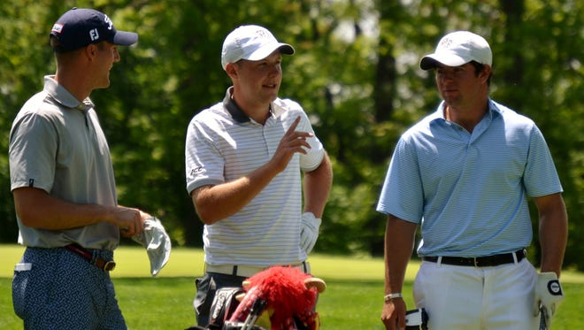 Garrett Rank (left), Paul McBride and Cameron Young (right) talk on the 10th tee of Winged Foot East during the Round of 32 at the U.S. Amateur Four-Ball Championship.