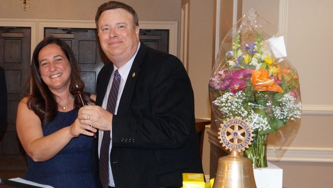 Incoming Vineland Rotary Club President Susanna Philippoussis receives the gavel from past president Wayne Triantos.