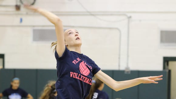 Pelham Memorial High School's Charlotte Krause hits the ball during a scrimmage against Yorktown High School at Yorktown High School, Aug. 29, 2017.