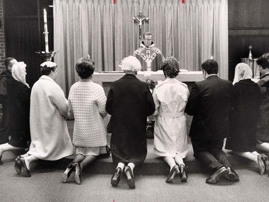 The Rev. Mark Dittami celebrating Mass at the chapel what was then the Bergen Mall.