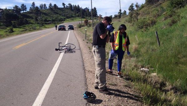 Coroner at the scene of a bike crash near Horsetooth Tuesday morning.